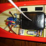 With hatch open and one battery pack installed with Velcro. Note Velcro at top of picture is sitting right on the hull.