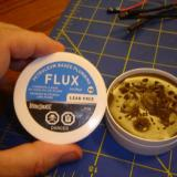 Flux is a poisonous jelly that helps make excellent soldering connections. Keep it out of and off of your body and out of the reach of children.
