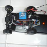The Micro-Baja with the body removed and the charger charging up the NiMH battery pack.