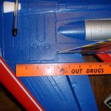 The ruler on the molded line, 6 3/8 inches from the back of the wing.