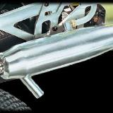 Muffler has dual chamber tuned pipe. Tuned for racing to get the most power out of engine.