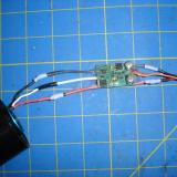 The motor and ESC soldered together to save weight, with battery connector soldered on as well
