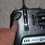 I am pointing to the throttle control on the transmitter.