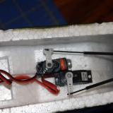 The installed Spektrum digital servo (I supplied) connected to the rudder with the hardware that came with the plane.