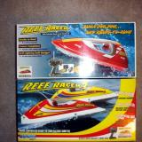 The box for the Original Reef Racer on top and the Reef racer 2 on the bottom.