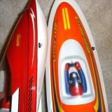 The exit holes for the cooling water are on the right sides of the boat in both models.