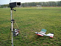 Name: DSC00261[1].jpg Views: 363 Size: 298.6 KB Description: simple FPV setup with the camera and transmitter on board held down by the rubberbands from the wing.