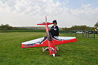 Name: Aaron with the AW Extra at RCMB 042112.jpg Views: 144 Size: 52.8 KB Description: Aaron with his plane at the RCMB Field 042112