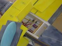 Name: radio_comp.jpg Views: 3350 Size: 41.3 KB Description: Notice hinged flap on top wing, for accessibility.  It is usually taped in place. Servos are set on ply rails.  Rails go through fuselage sides for a very durable setup. Receiver is velcro'd to the side