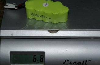 In this corner, the stock NiMH battery, weighing in at 6.8 ounces.