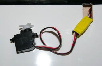 Securing the servo extension with electrical tape
