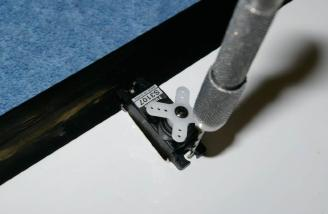 A small pilot hole helps prevent splitting the wood when installing the aileron servos.
