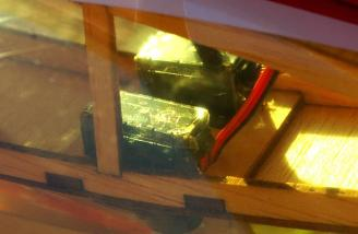The two aileron servos as viewed though the beautiful translucent Ultracote covering.
