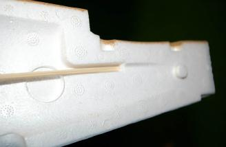 Use the indentation cast into the foam as your guide for where the pushrods need to penetrate the fuselage sides.