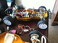 Name: iphonr 003.jpg Views: 133 Size: 215.4 KB Description: Modern 2.2's, new esc, motor, servo... I have the original stuff too.  Original ANDY's kit is included as well