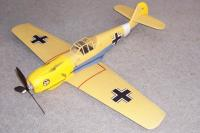 Name: GWS-109.jpg Views: 267 Size: 88.0 KB Description: Fully Fiberglassed ME-109.  Clocked with radar at 56 mph -- draws 12.6 amps, at WOT.  Currently at 47 flights, and 16.82 hours in the air.  The weak spot on the fuselage (where the white band is) shows no signs of stress.