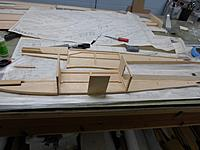 Name: 9.jpg Views: 120 Size: 222.5 KB Description: First two bulkheads glued in place and dry fit of main landing gear plate