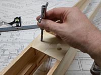 Name: 08.jpg Views: 62 Size: 88.8 KB Description: Underlying hardwood blocks are tapped using light hand pressure.  Note ¼-20 nylon bolt in threaded hole.