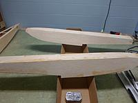 Name: Image00015.jpg Views: 70 Size: 126.4 KB Description: Floats rough sanded, I cut the box top to make a quick cradle to hold them upright to assist with stabilization when I apply the glass
