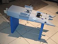 Name: 015.jpg Views: 346 Size: 65.6 KB Description: I had to make a stand out of EVA foam, which I cut to shape the fuse at both ends.