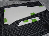 Name: DSC02273.jpg Views: 86 Size: 160.2 KB Description: After cutting out wings and ailerons, they are taped together and sanded to minimize left/right variation.