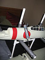Name: IMG_1910.jpg Views: 37 Size: 110.2 KB Description: b/c its nose heavy i added this strap for safety. Nose should be heavy enough with this bungee/strap to keep it from moving off the stand.