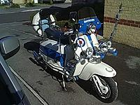 Name: 4855175999430290352.jpg Views: 150 Size: 71.2 KB Description: 1963 Lambretta LI150 Series 3 fitted with an RB200 kit by the legendary Ron Moss. Full suspension mods and disc brake conversion.