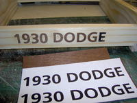 Name: Dodge 286.jpg Views: 166 Size: 81.7 KB Description: Mahogany veneer was stained the same color as the hull.  Letters were cut out and glued to pine cradle.  The paper is partly removed from the E on the cradle.