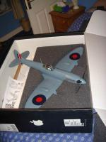 """Name: 3.jpg Views: 451 Size: 88.3 KB Description: FSK Spitfire. As this model is one peice (ie wing stuck to fuzz) I used an Apple Mac 32"""" monitor box with foam to make a transport box. Works very well too."""