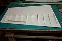 Name: Fokker E V_009.jpg Views: 104 Size: 49.2 KB Description: Overall view of one wing foam core ribs, bottom spruce spar and balsa trailing and leading edge of the aileron insert.  Large area of material in front of the ribs is the upper wing skin which is folded over and glued.