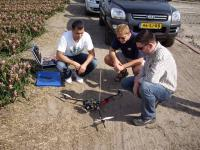 Name: f070414100142_0640.jpg Views: 337 Size: 81.1 KB Description: Peter, Frederic and Bert looking over Peter's tricopter