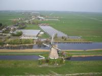 Name: f070414154458_0640.jpg Views: 206 Size: 78.4 KB Description: One of the three windmills near Stompwijk