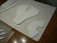 Name: 005.jpg Views: 138 Size: 154.7 KB Description: wing and tail parts laminated ready for sanding, tailfeathers were also 2 layers