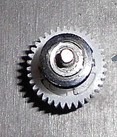 Name: Forward Gear drive wear 2.jpg Views: 100 Size: 195.1 KB Description: This worn gear cap needs something to shim it up against the bearing better.
