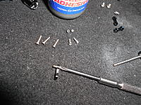 Name: DSCN0994.jpg Views: 89 Size: 305.0 KB Description: Insert the screw, with bushing, into the black linkage.