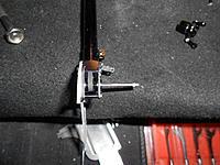 Name: DSCN1015.jpg Views: 93 Size: 222.1 KB Description: Install the aluminum bracket for the tail steering rocker.