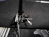 Name: DSCN1016.jpg Views: 89 Size: 305.3 KB Description: Install the tail steering rocker with brass bushing inserted.