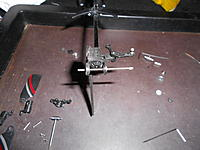 Name: 09.jpg Views: 498 Size: 139.6 KB Description: I wanted to reassemble the rotor assembly first so i installed the shaft now by itself. You may want to install the included spacer and metal gear at this point and then install this shaft.
