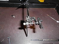 Name: 19.jpg Views: 491 Size: 129.9 KB Description: Install the tensioner. I adjusted the tension till i could turn the tail rotor with my hand and the clutch would not slip any longer, allowing the main rotor to turn with the tail rotor as i spun it.