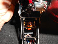 Name: DSCN3279.jpg Views: 94 Size: 206.2 KB Description: Using the mounting screws that i already had inside the frame from the last motor, i screwed in the new motor and set the gear mesh.
