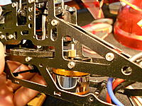 """Name: DSCN3284.jpg Views: 82 Size: 301.2 KB Description: The pinion is the stock 4F200 pinion. It had a 2mm """"keyed"""" shaft hole. The new motor's shaft is 2.3mm """"keyed"""". I used a big table vice to force press the pinion on. Using the pressure, release pressure, pressure again method."""