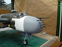 Name: P1020628.jpg Views: 185 Size: 143.9 KB Description: Strafer nose with machine guns temporarily installed. You can see I have started to remove the paint from the fuselage.