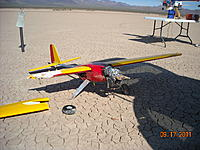 Name: DSCN0301.JPG Views: 82 Size: 2.05 MB Description: Crash aftermath...busted Byrofoam wing, plastic pod damaged, aluminum tube fuse and landing gear bent