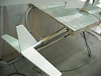 Name: DSCN0507.JPG Views: 24 Size: 232.8 KB Description: In the paint booth again...here's a shot of my setup for painting the tail parts (the wings are right above it)