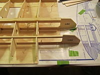 Name: 835.jpg Views: 187 Size: 173.9 KB Description: Using the included set back gauge to correctly position the wing spars. Note that I also cut the matching angle on the ends of the upper spar ends.