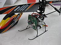 Name: IMG_1979.jpg Views: 60 Size: 172.5 KB Description: With V911 Rx board, canopy and skids (blades only there because old blades had developed some damage on the pivot). V922 carbon main shaft
