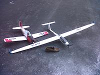 """Name: IMG-20130408-00987.jpg Views: 45 Size: 223.7 KB Description: My new """"biggest plane"""", a FMS ASW 28 motorglider, next to my T-28, the former holder of the title, and my shoe... for scale."""