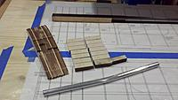 """Name: 2012-11-24 09.56.06.jpg Views: 84 Size: 135.7 KB Description: Parts ready to go, including the two added lighter color W1 ribs for the extended span (36"""" inner panel span).  The shear webs are laminated and their tops sanded per Jack's instructions to match the rib contour.  And the laminated ply outer joiner."""