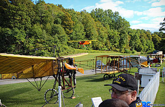 "1929 Curtiss Robin on approach with the ""gang"" looking on"