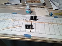 Name: First rib glued.jpg Views: 100 Size: 669.6 KB Description: First rib glued in place with plastic 90 degree jigs.